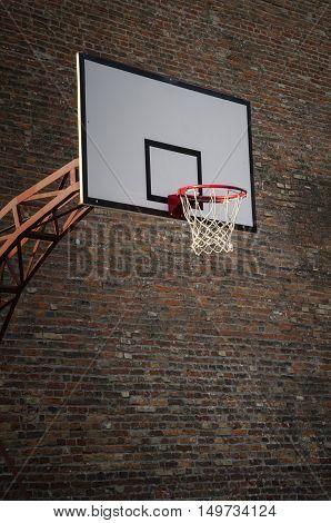 Basketball hoop on empty outdoor basketball court