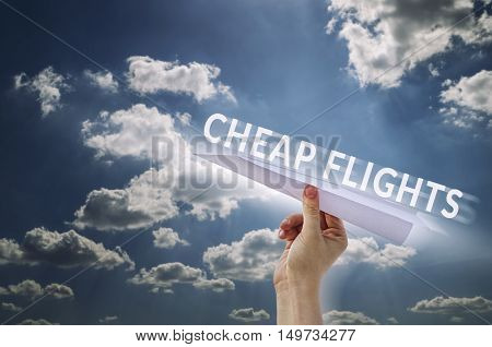 Paper plane in hand with cloud background. Cheap flights concept.