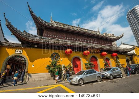 Shanghai China - October 26 2013: A wide-angle view of the Jade Buddha Temple exterior (founded 1882) in Shanghai China. Buddhism is enjoying a revival in modern liberal China.