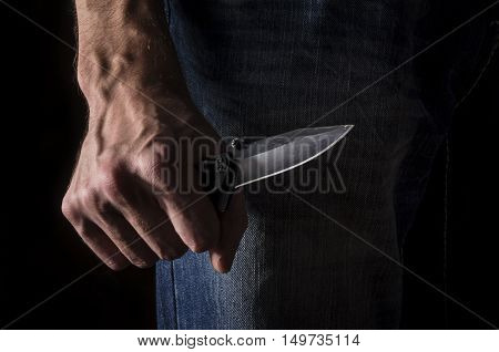 The man with a knife in a hand closeup.