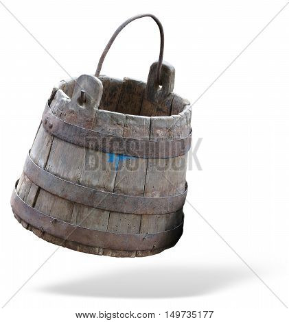 Vintage wooden bucket with metal ring and handle isolated over white background
