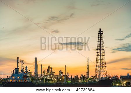 Sunrise over oil refinery, heavy industrial manufactory over natural sunrise background
