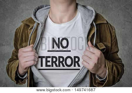 Man showing NO TERROR title on t-shirt