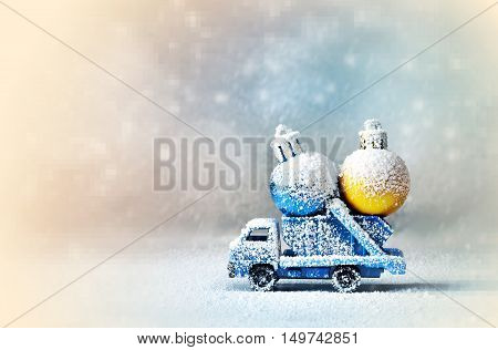 Christmas decoration. Truck car carries decorations for Christmas trees. Christmas ball.