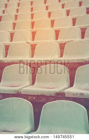 Empty old seats in a sports stadium
