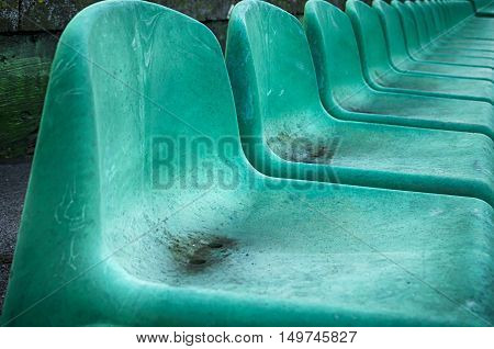 Empty seats in a sports stadium. Shallow depth of field.