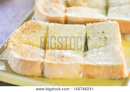 toast with butter topping dish , toast