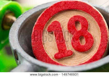 eighteen, a red bingo number in wood