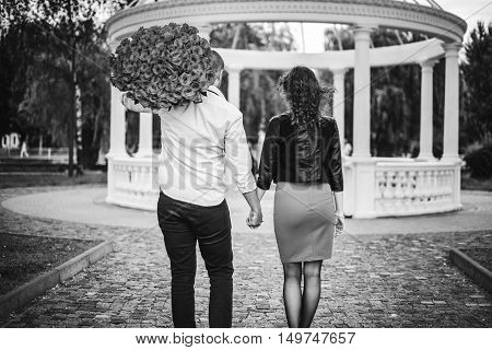Young happy couple walking in the park
