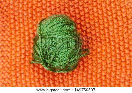 Green Ball Of Wool On Orange Cloth Woven Wool