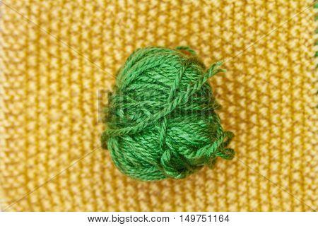 Green Ball Of Wool On Yellow Cloth Woven Wool