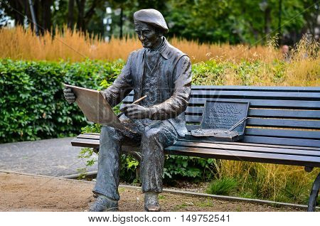 12 August 2016 Gdynia-Poland Sculpture of famous painter Antoni Suchanek in a park in Orlowo Poland. Editorial photo