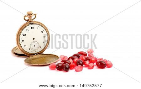 picture of a omega 3 capsules and pomegranate fruit on the white background.