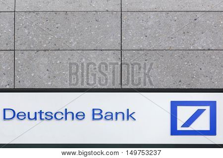 Milan, Italy - September 15, 2016: Deutsche Bank logo on a wall. Deutsche Bank is a German global banking and financial services company with its headquarters in the Deutsche Bank Twin Towers in Frankfurt