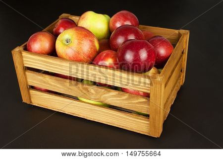 Fresh red autumn apples in farmhouse style wooden crate. Sales of farm products. Advertising for the sale of fruit.