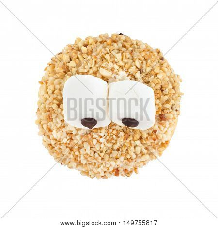 White chocolate donut sprinkled with nuts isolated on white background