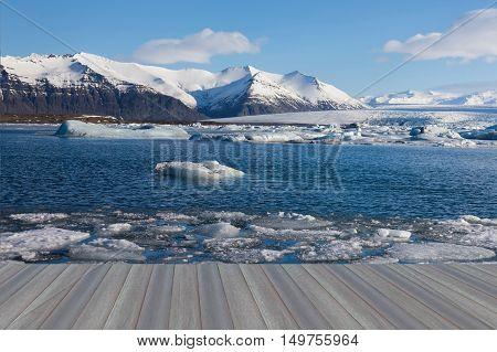 Opening wooden floor, Jokulsarlon lagoon in winter season, Iceland natural landscape background