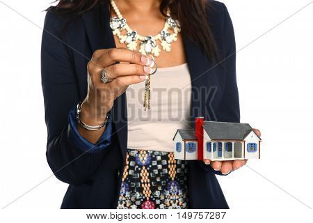 Female real estate agent holding house and keys isolated over white background