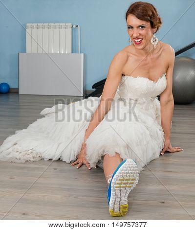 Bride doing split stretching, square image, toned image