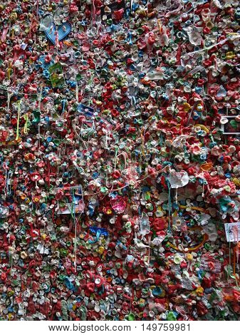 SEATTLE- JUNE 24 : Close-up of The Market Theater Gum Wall in downtown Seattle on June 24 2016. It is a local landmark in downtown Seattle in Post Alley under Pike Place Market.