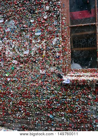 SEATTLE- JUNE 24 : Close-up of The Market Theater Gum Wall and window in downtown Seattle on June 24 2016. It is a local landmark in downtown Seattle in Post Alley under Pike Place Market.