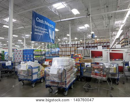 HONOLULU - JANUARY 4 2016: Sam's Club interior with pick up orders ready for pick up and products. Sam's Club is an American chain of membership-only retail warehouse clubs owned and operated by Walmart.