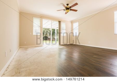 Room with Gradation from Cement Floors to Hardwood Flooring Installed.
