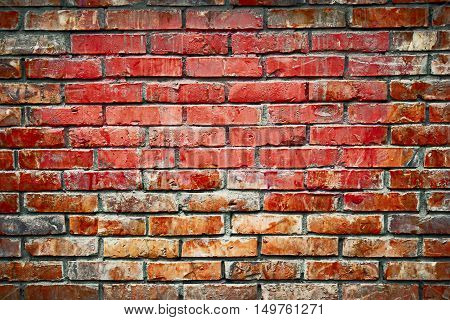 Old brick wall background image. Weathered texture of stained old dark brown and red brick wall, grungy obsolete blocks of stone-work technology.