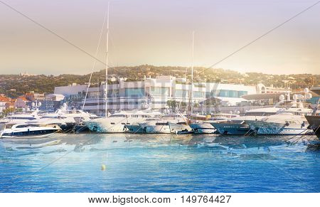 CANNES, FRANCE - 19 SEPTEMBER, 2016: Vieux Port (old port) in the city of Cannes, with lots of sailing boats and power yachts anchored during the Sailing regatta
