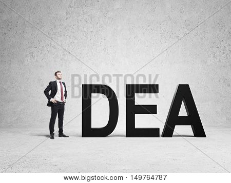 Man in suit is being the letter in the word idea. Concept of creative approach to business processes. Mock up