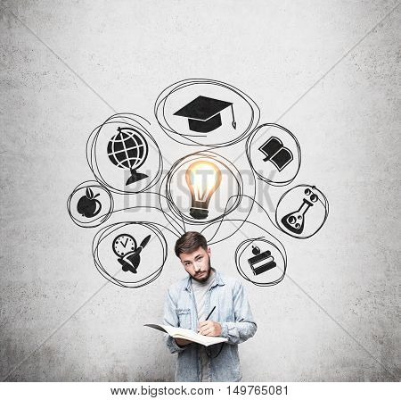 Man with beard in casual clothes is standing near concrete wall with education sketches on it. Concept of choosing your way in life