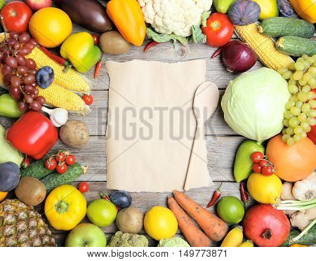 Ripe Fruits And Vegetables With Blank Sheet Of Paper On Wooden Table
