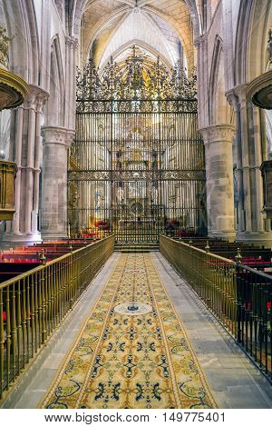 CUENCA SPAIN - August 24 2016: Interior of the cathedral of Cuenca Major Chapel or High altar Closed by three grills Constructed in marble of carrara and jasper the marble was worn out for Blas de Renteria the sculptures and reliefs of the altar are a wor