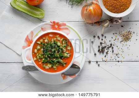 gazpacho soup on a background of spices and ingredients