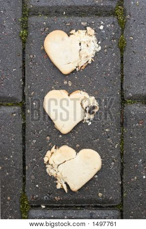 Three Broken Hearts On Asphalt