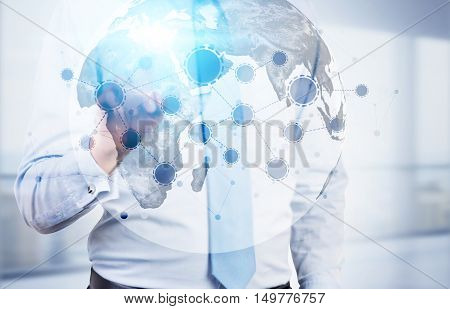 Torso of man touching Earth hologram with startup sketch. Concept of the future is now. Toned image. Double exposure
