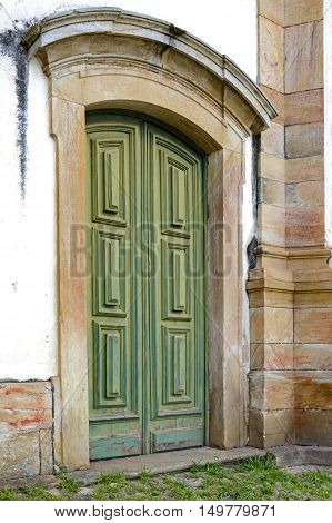 Old and aged wooden church door with beautiful colors and texture in Ouro Preto city