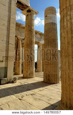 Old walls and columns of the ruined temple complex of Acropolis of Athens convey the grandeur of the ancient building
