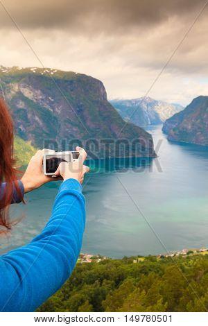 Tourist Taking Photo From Stegastein Viewpoint Norway