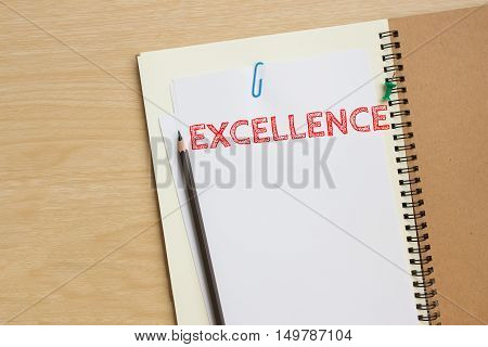 text excellence on white paper note with pencil on table wood