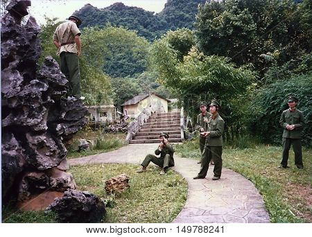 YANGSHUO / CHINA - CIRCA 1987: Chinese soldiers on leave enjoy the mountain scenery and take photographs around Yangshuo.