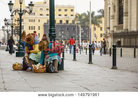 LIMA PERU - SEPTEMBER 21 2016: A Peruvian Women Selling Sweets in the Streets of Lima Peru.