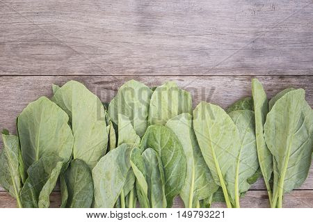 Green Fresh Gai Lan (chinese Broccoli) On Wooden Plank