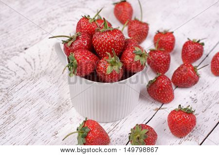 strawberry on a white color wooden background