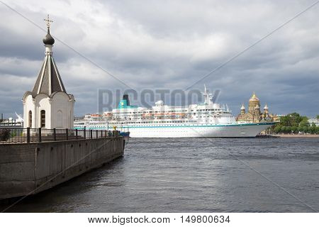 SAINT PETERSBURG, RUSSIA - JUNE 18, 2016: Chapel of St. Nicholas and the cruise ship