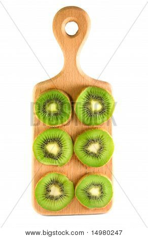 Slices Of Kiwi On The Vertical Cutting Board Isolated