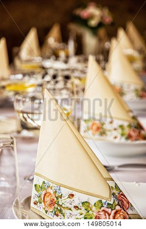 Decorative napkins and glasses of vermouth with lemon on the table. Birthday party. Refreshments theme. Alcoholic drink. Vertical composition.