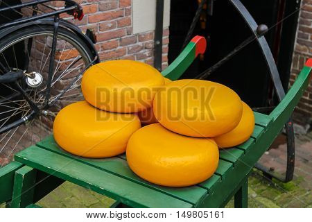 Dutch cheese on traditional wooden barrow in Amsterdam Netherlands
