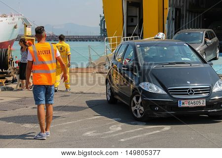 Piombino Italy - June 30 2015: Unloading vehicles from ferry boat Corsica Express in the seaport