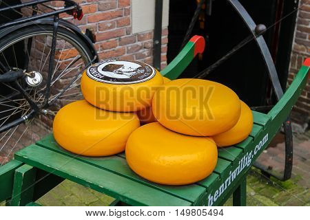 Amsterdam the Netherlands - October 03 2015: Dutch cheese on traditional wooden barrow in city centre